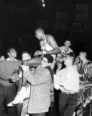A group carries basketball players on shoulders, 1957