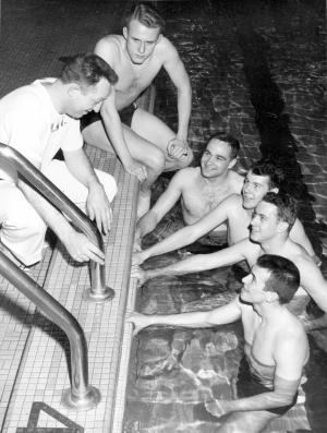 Coach Mc Caffree with MSU swimmers, n.d.