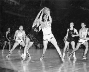 Basketball players fight for the ball, ca. 1950-1951