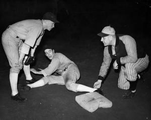 A baseball player's slide is disputed, date unknown